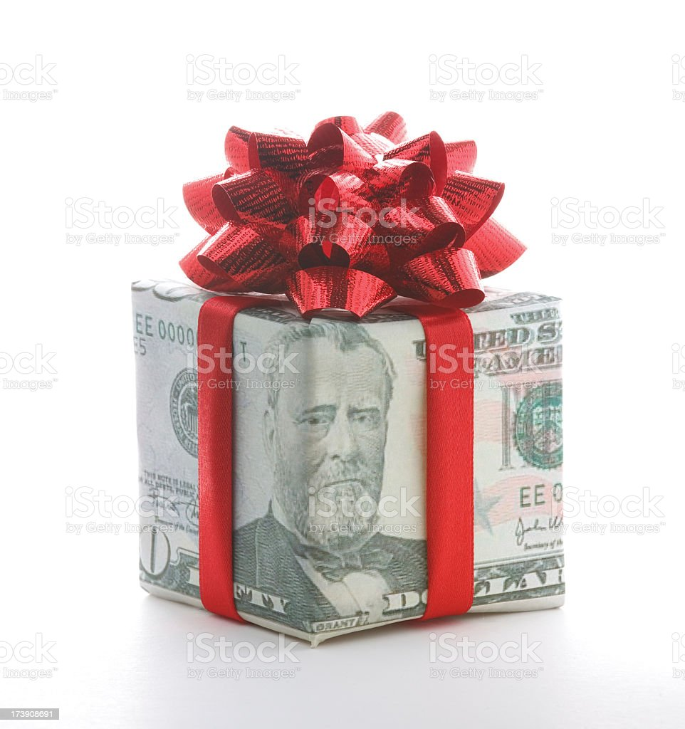 Fifty dollar bill folded as a gift box decorated with bow stock photo