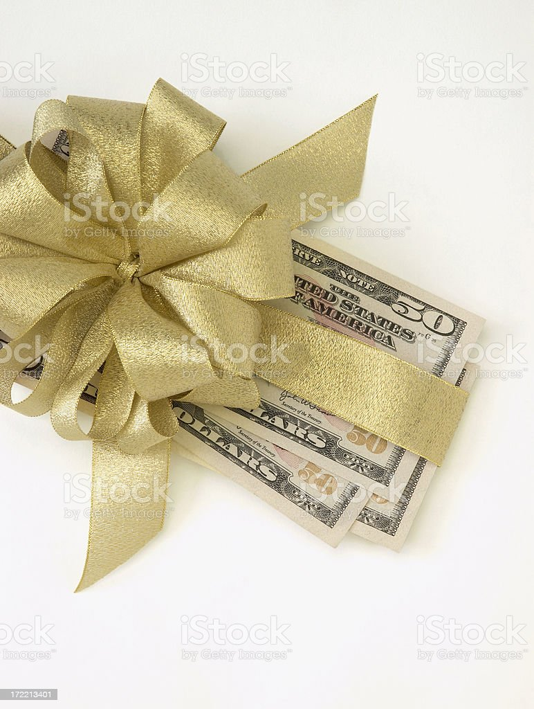 Fifty Dollar Bills with Gold Bow stock photo