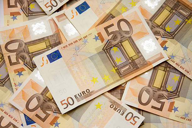 Fifty euro banknotes Lots of Fifty euro banknotes fifty euro banknote stock pictures, royalty-free photos & images