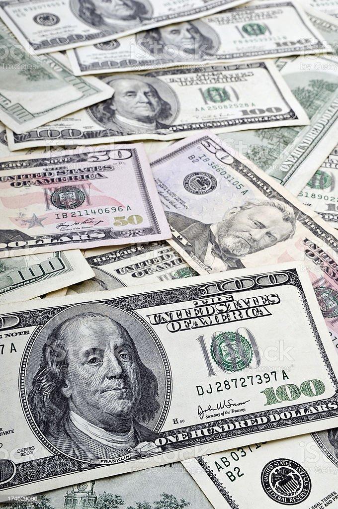 Fifty & Hundred Dollar Bills stock photo