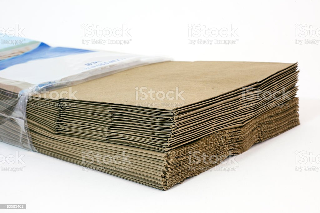 Fifty New Brown Paper Bags stock photo