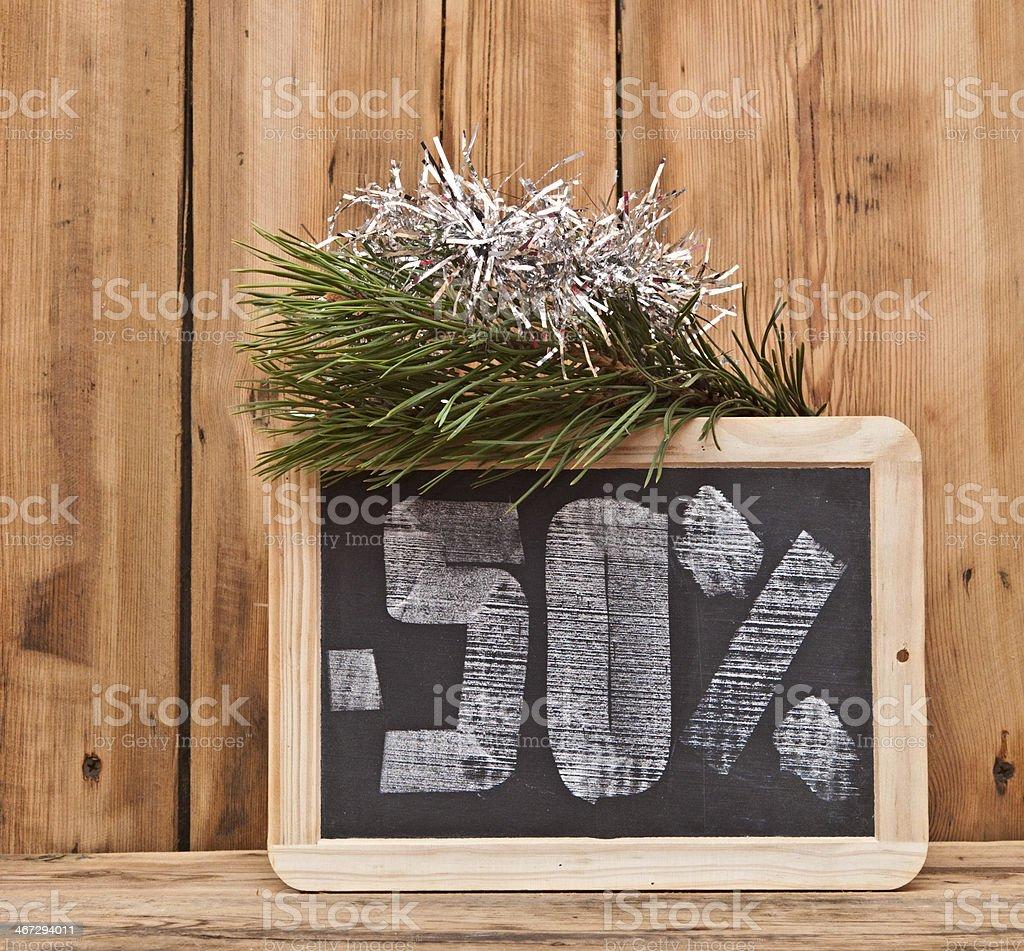 fifty percent discount written on blackboard stock photo