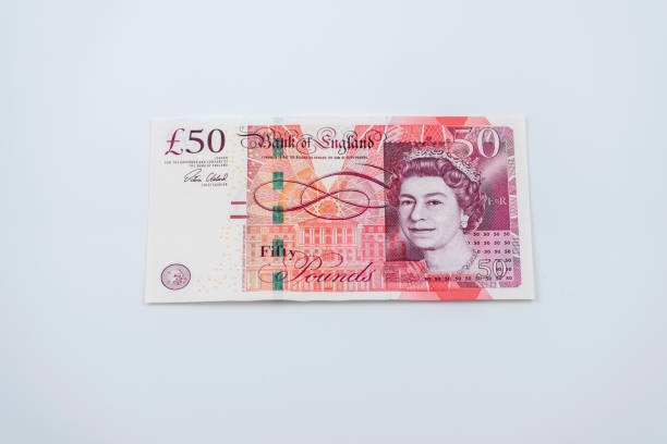 Fifty Pound Note Fifty pound note on the white background. british currency stock pictures, royalty-free photos & images
