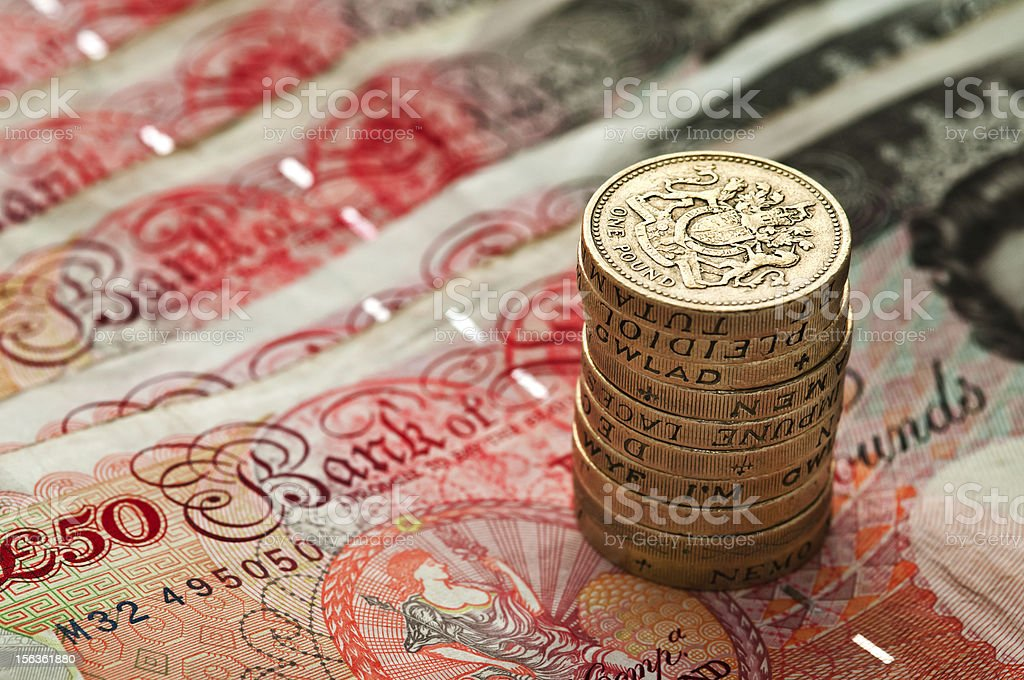 Fifty pounds sterling and coin stack - UK Currency Macro royalty-free stock photo