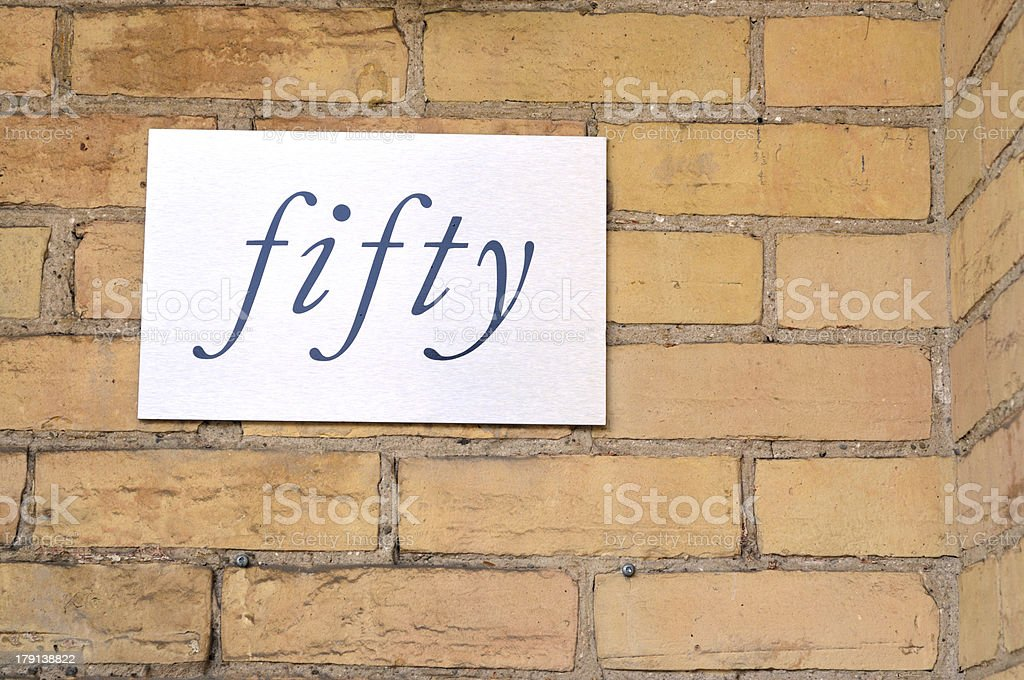 Fifty sign on wall royalty-free stock photo