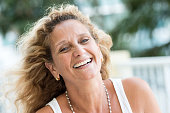 Fifty something woman smiling looking at the camera