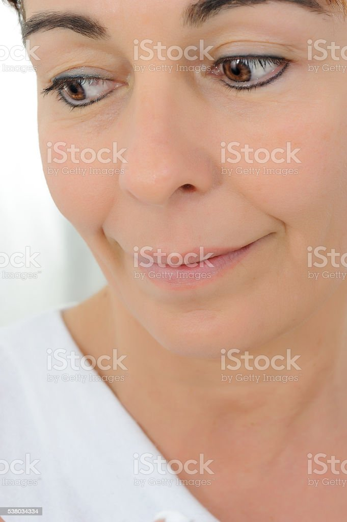 fifty year old woman with fake smile stock photo