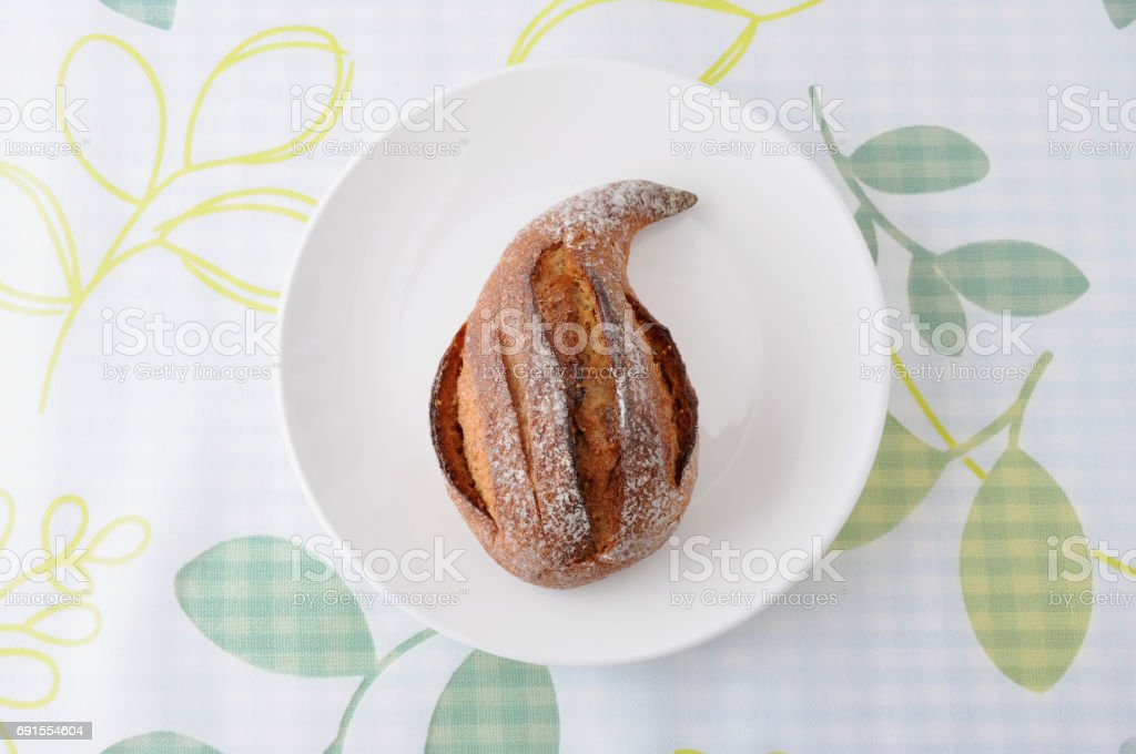 fig bread french roll on plate on table