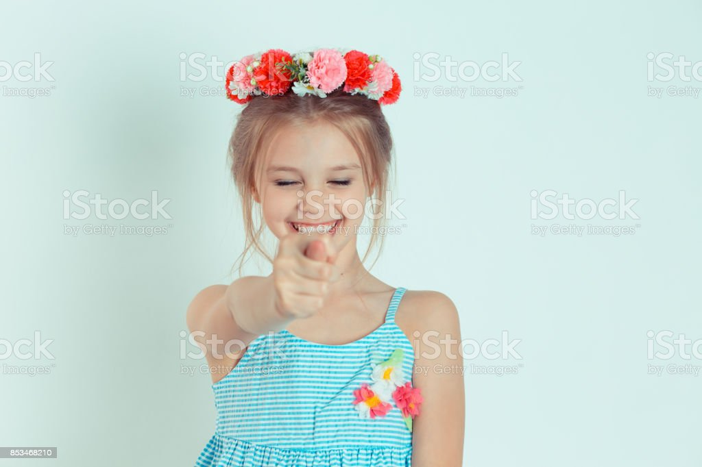 Fig. Closeup portrait smiling woman gesturing with thumbs, finger that you get zero nothing, isolated green background. Negative emotion facial expression feelings body language sign. Failed negotiation stock photo