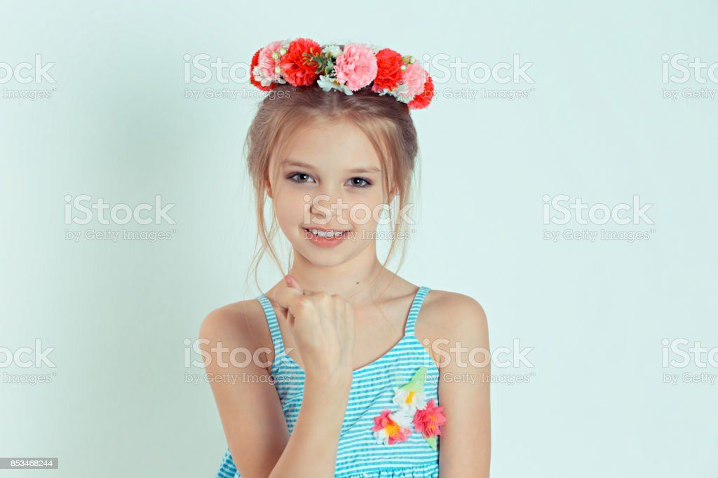 Fig. Closeup portrait upset woman gesturing with thumbs, finger that you get zero nothing, isolated green background. Negative emotion facial expression feelings body language sign. Failed negotiation stock photo