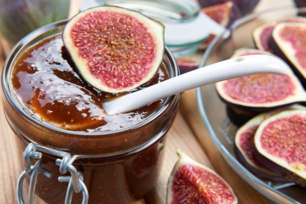 Fig jam in a jar. Homemade fruit jam stock photo