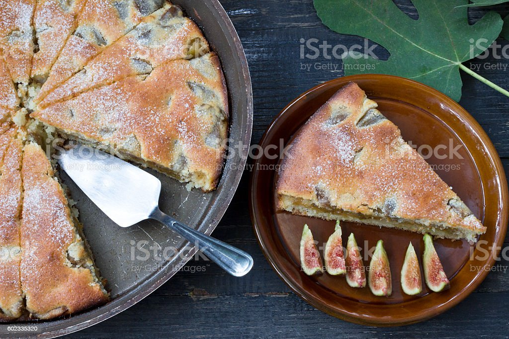 Fig pie on a wooden background stock photo