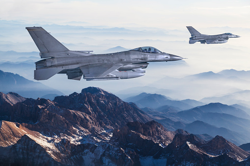 Figher Jets Flying Over The Mountains Stock Photo - Download Image Now