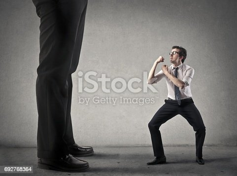 istock Fight against someone bigger 692768364