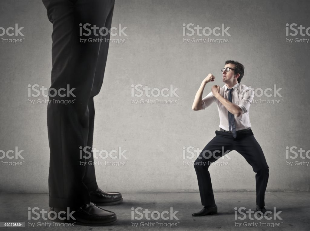 Fight against someone bigger stock photo