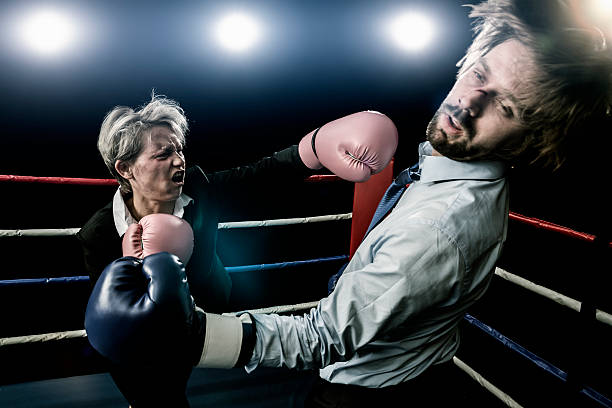 Fight between businessman and businesswoman stock photo