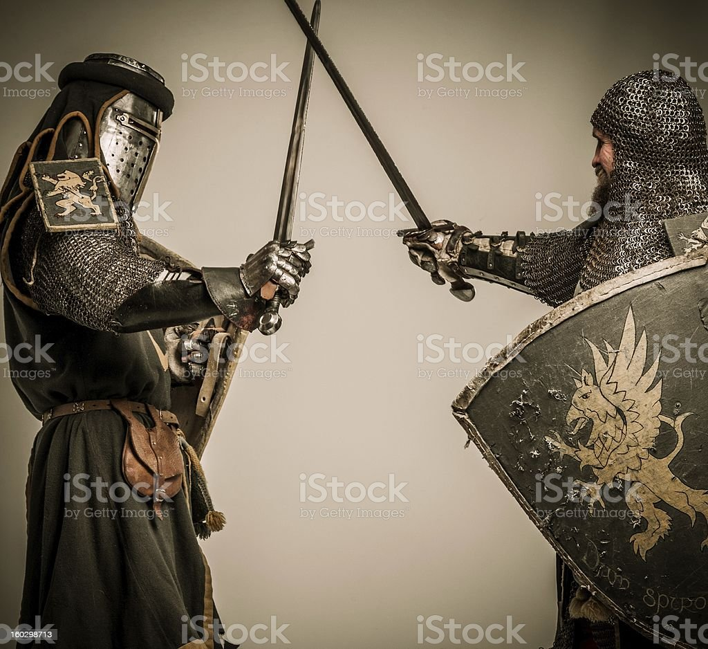 Fight between two medieval knight royalty-free stock photo