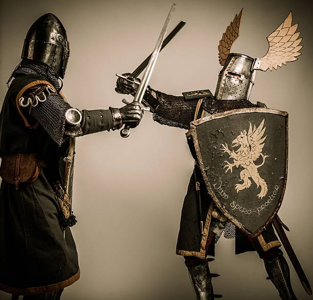 Fight between two medieval knight stock photo