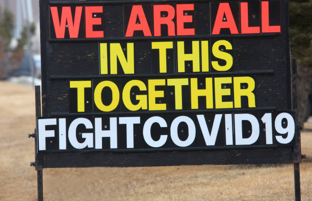 Fight Covid-19 Sign In Front of Business stock photo