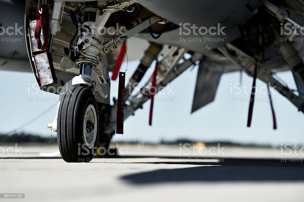 Fighter aircraft detail with landing gear stock photo