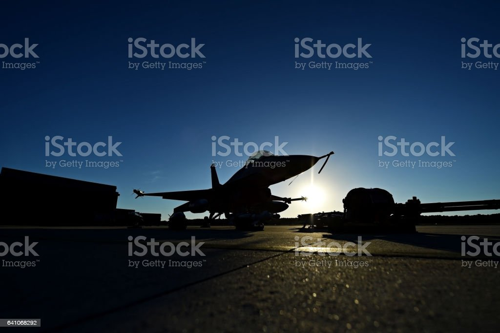 Fighter aircraft silhouette at sunset stock photo