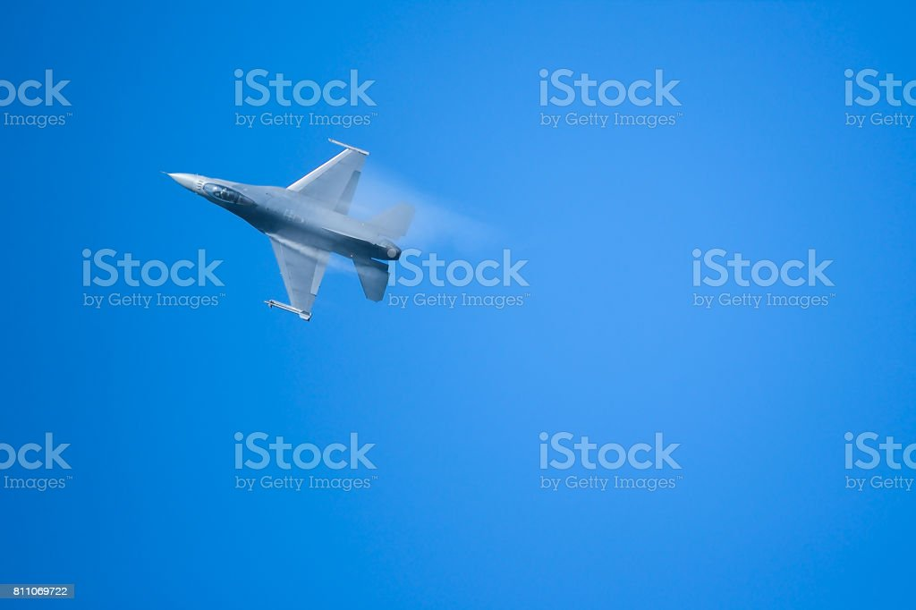 F16 fighter aircraft's vapor condensation on its wing stock photo