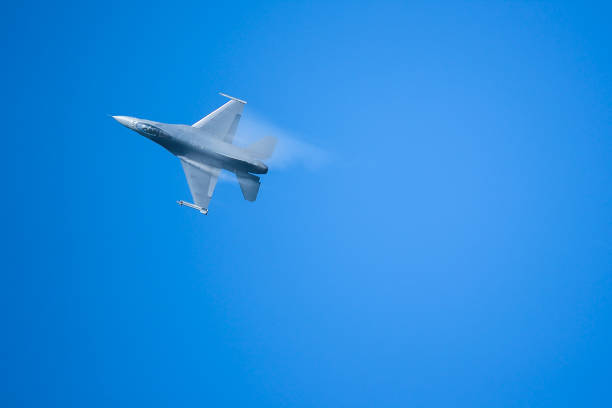 f16 fighter aircraft's vapor condensation on its wing - sonic boom stock photos and pictures