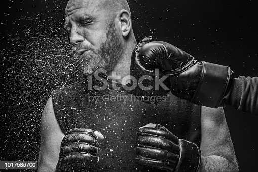 Bearded Aggressive Adult Man MMA fighter being knocked out