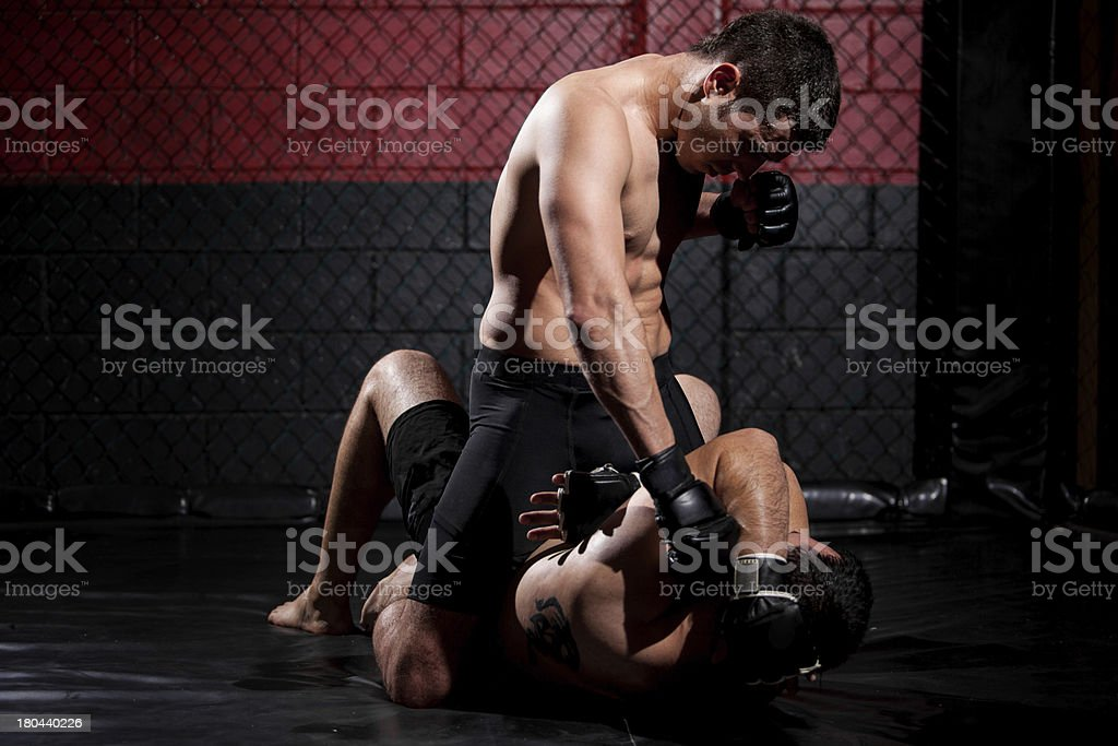 MMA fighter dominating the match stock photo