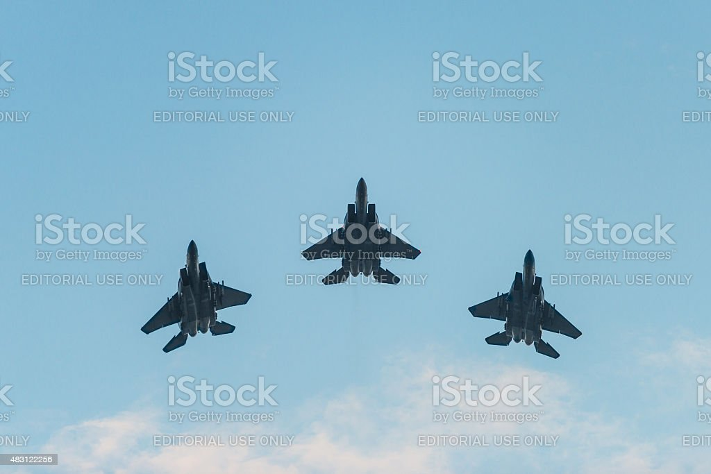 fighter formation flew over the city stock photo