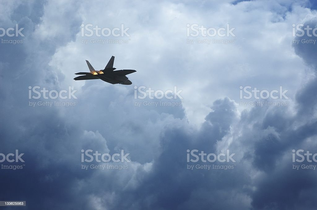 Fighter Jet Above Clouds royalty-free stock photo
