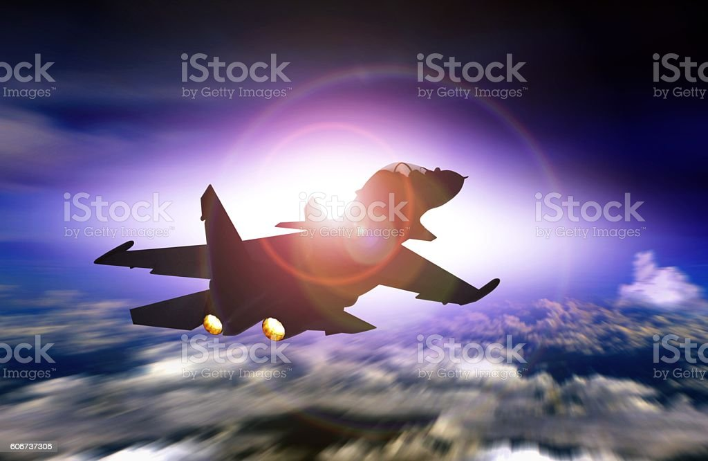 Fighter jet flying facing sunset stock photo