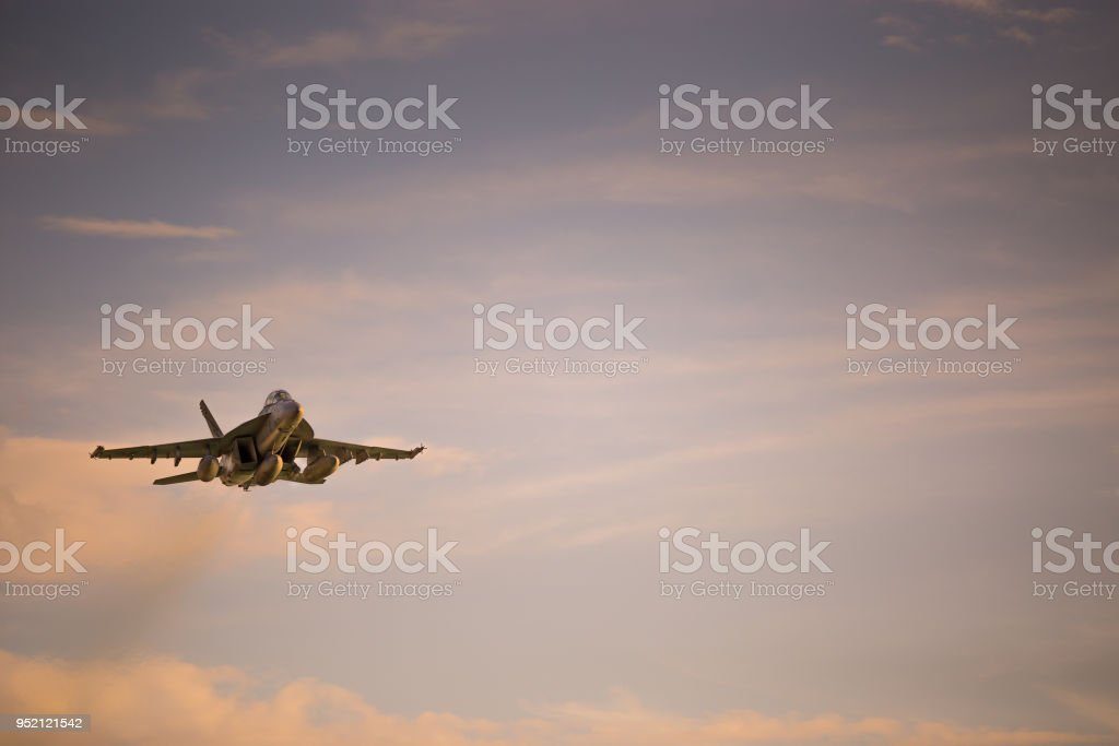 Fighter jet flying low stock photo