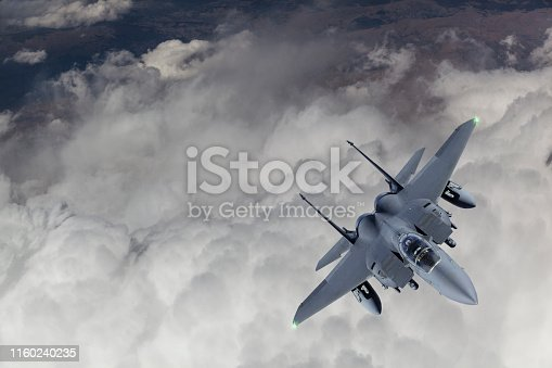 F-15 Fighter Jet flying over clouds