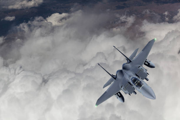 F-15 Fighter Jet flying over clouds F-15 Fighter Jet flying over clouds fighter plane stock pictures, royalty-free photos & images