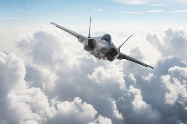 Fighter Jet flying over the clouds Fighter Jet flying over the clouds air force stock pictures, royalty-free photos & images