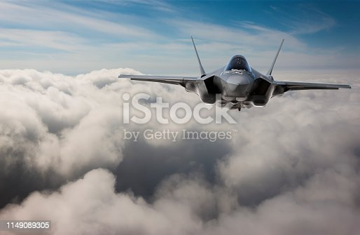 1145066973 istock photo F-35 Fighter Jet flying over the clouds 1149089305