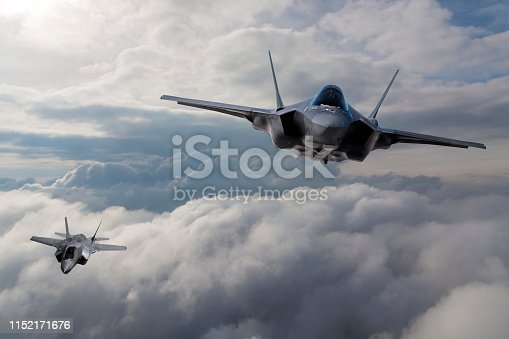 1145066973 istock photo F-35 Fighter Jet flying over the clouds 1152171676