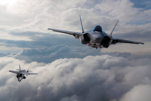 F-35 Fighter Jet flying over the clouds stock photo