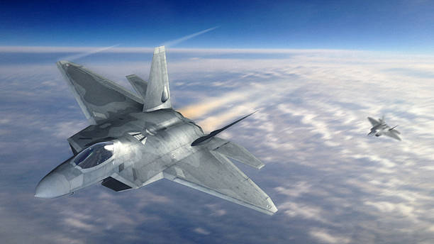 Fighter Jet in Atmosphere A high resolution image of a military fighter jet flying in earth's atmosphere, stealth stock pictures, royalty-free photos & images