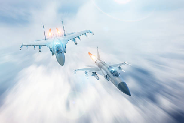 Fighter jet intercepts accompanies another fighter. Conflict, war. Aerospace forces. Fighter jet intercepts accompanies another fighter. Conflict, war. Aerospace forces fighter plane stock pictures, royalty-free photos & images