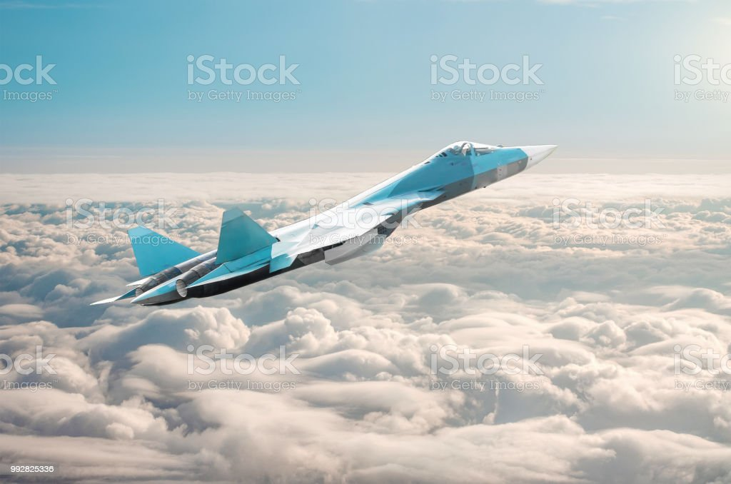 Fighter jet on a combat mission above the clouds. Fighter jet on a combat mission above the clouds Aerodynamic Stock Photo