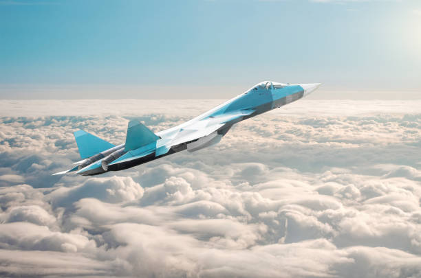 Fighter jet on a combat mission above the clouds. Fighter jet on a combat mission above the clouds supersonic airplane stock pictures, royalty-free photos & images