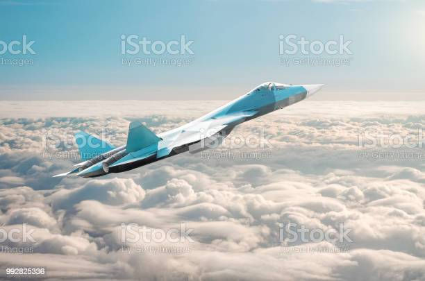 Fighter Jet On A Combat Mission Above The Clouds Stock Photo - Download Image Now