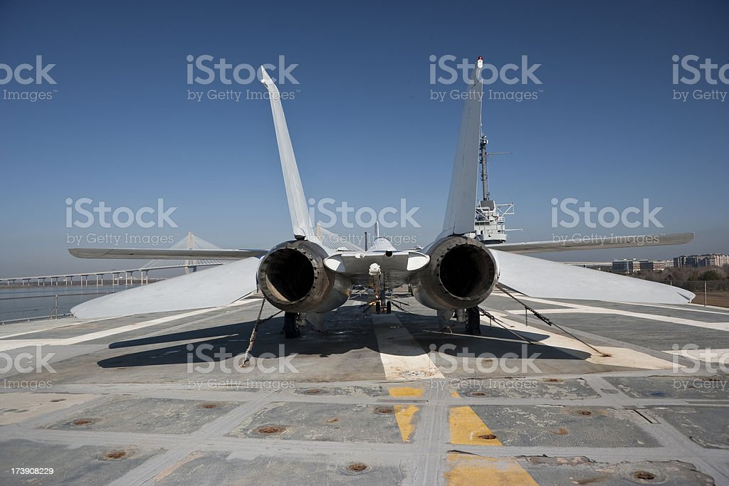 Fighter jet on an aircraft carrier royalty-free stock photo