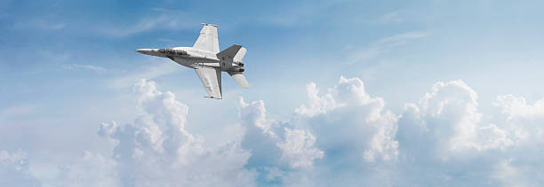 F-18 Fighter Jet Panorama Panoramic view of an F-18 fighter jet cutting across the sky. advanced tactical fighter stock pictures, royalty-free photos & images