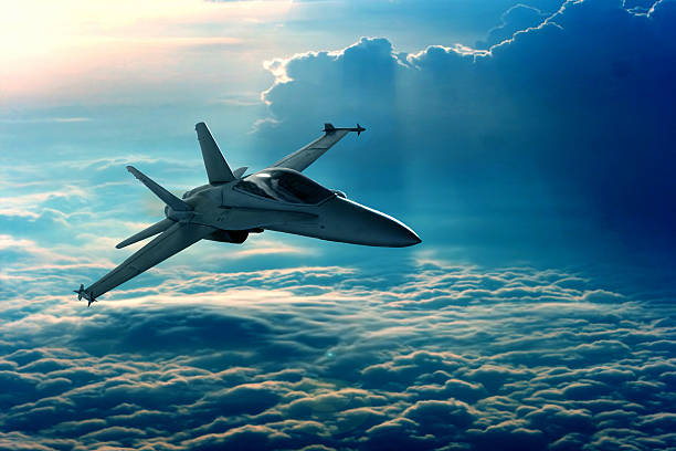 Fighter jet View of a fighter jet above the clouds air force stock pictures, royalty-free photos & images