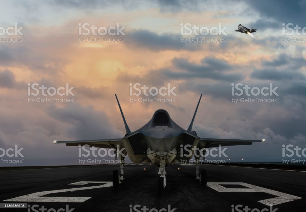 F-35 fighter jet ready to takeoff on runway at sunset F-35 fighter jet ready to takeoff on runway at sunset Aerospace Industry Stock Photo