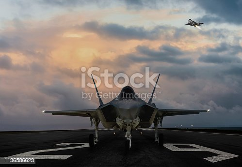 F-35 fighter jet ready to takeoff on runway at sunset
