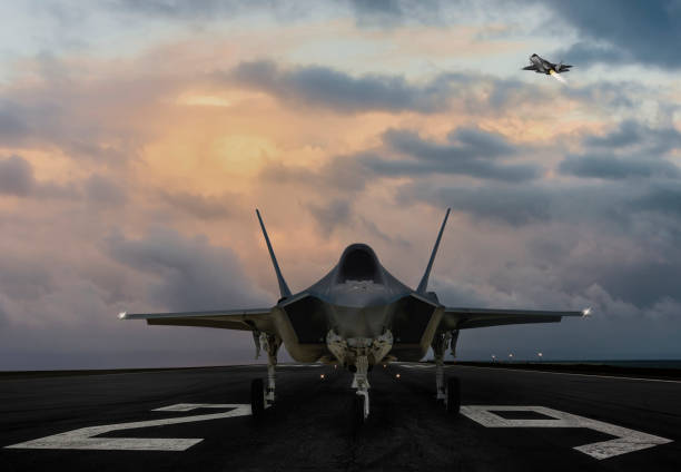 F-35 fighter jet ready to takeoff on runway at sunset F-35 fighter jet ready to takeoff on runway at sunset fighter plane stock pictures, royalty-free photos & images